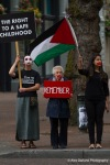 Demonstrators arrive at Occidental Park in Seattle to silently counter protest a pro Israel demonstration.