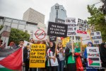 Protestors rally against violence by Israel in Palestine.