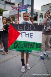 A child protests the occupation of Palestine by Israel