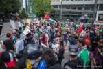 A large crowd of pro Palestine activists demonstrate against violence in Gaza.