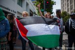 Protestors rally for peace at a rally in solidarity with Palestine at Westlake Park, Seattle.