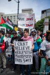 Demonstrators line the sidewalks of Westlake Park at a pro Palestine rally in Seattle, WA.