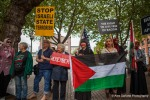 Pro Palestine activists stand in silence to protest the rally held in support of Israels actions in Gaza.