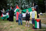Young demonstrators wave Palestinian flags as they wait for President Obama to arrive for a fundraising dinner in Seattle, Washington