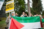 Demonstrators chant, holding Palestinian flags and anti-Israeli apartheid signs