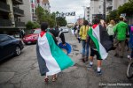 Activists wearing Palestinian flags march through the streets of Seattle, banging buckets and pans in protest of Israeli war crimes.