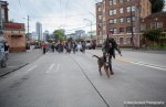 A demonstrator marches with their barking dog during the Anti-Genocide Noise Brigade.