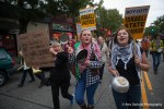 Demonstrators bang pots and pans as they march through Seattle during the Anti-Genocide Noise Brigade