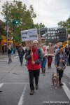 An activist shares a simple message as they march through Seattle protesting Israeli War Crimes