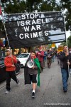 "A boy wearing a Palestinian flag leads a chant of ""Free Free Palestine"" as demonsrators march through Seattle."