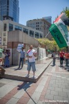 A demonstrator waves a Palestinian flag at Westlake Park in Seattle
