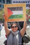 A protestor shows her support during a pro Palestine rally in Seattle, Washington.