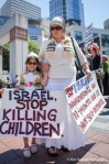 A mother brings her daughter to protest the current deaths of Palestinian children by Israeli bombs.