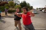 An activist is chased away by a sheriffs deputy during an eviction of a disabled veteran in Seattle.