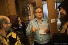 A consulate official explains that they have received the petition, but that the group needs to leave the building.